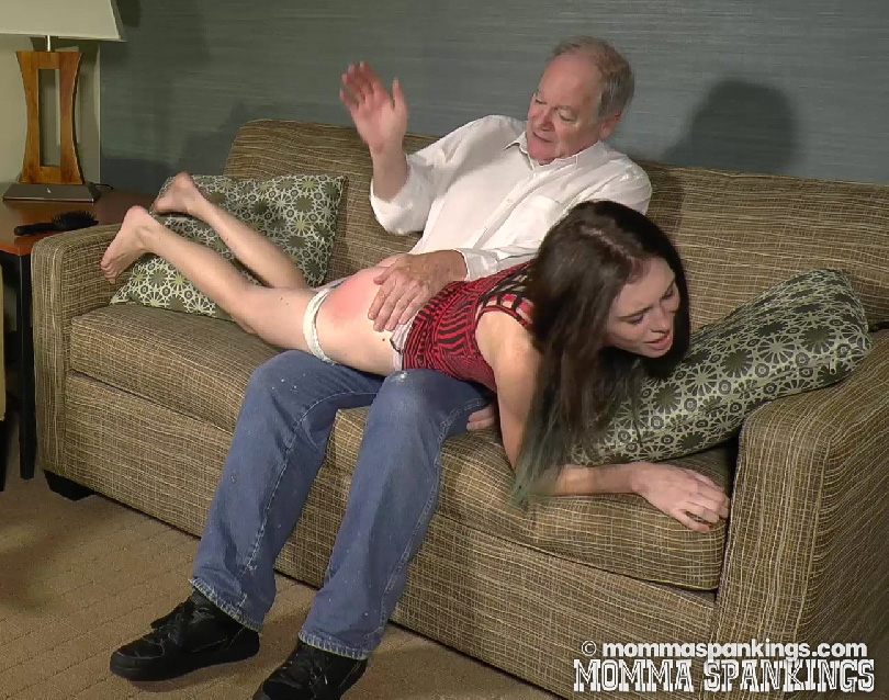 She receives the hand, the hairbrush, and the strap.